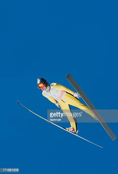 Ski jumper in mid-air equipped with camera