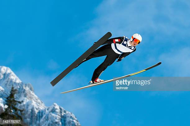Ski jumper in mid-air