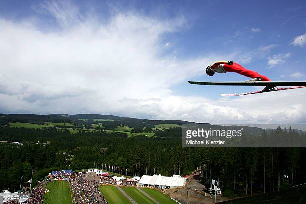 A ski jumper jumps over the black forest landscape during the FIS Summer Grand Prix on August 7 2005 in Hinterzarten near Freiburg Germany