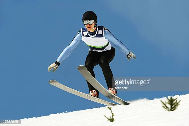 ski jumper landing - ski jumping stock pictures, royalty-free photos & images