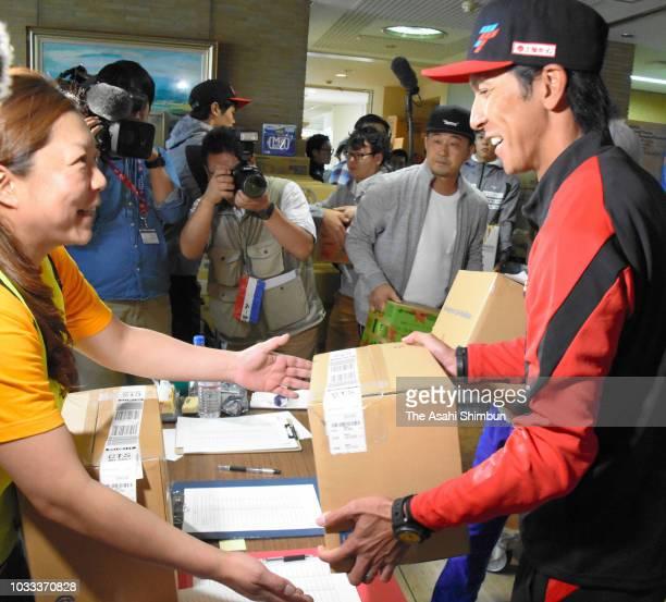 Ski jumper Noriaki Kasai brings aid supply after the magnitude 67 earthquake on September 12 2018 in Mukawa Hokkaido Japan