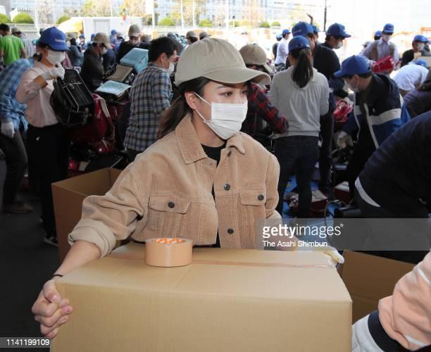 Ski jumper Sara Takanashi helps in preparation for shipping used school bags to Afghanistan on April 6 2019 in Yokohama Kanagawa Japan