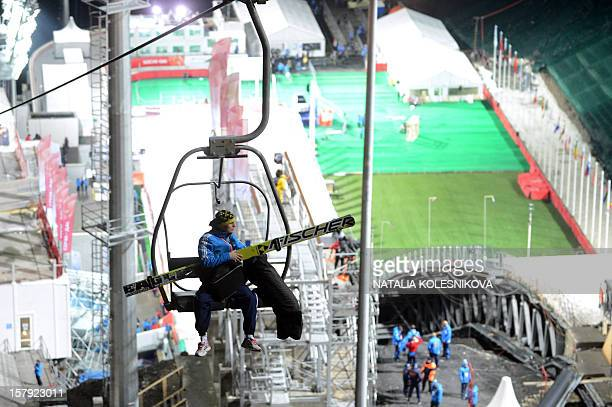 A ski jumper sits on a chairlift at the Russki Gorki ski jumping centre which will host the ski jumping and the Nordic combined events at the...