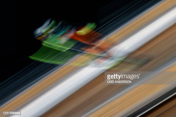 Ski jumper soars through the air during the first round jump of the women's team HS106 ski jumping event at the FIS Nordic Ski World Championships in...