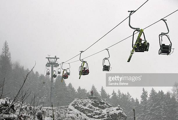 Ski jumpers go down the hill by lift because of bad weather conditions during the ski jumping event of the Nordic Combined World Cup on January 03...