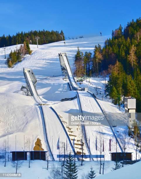 ski jumping inrun in an world class sports center - スキージャンプ ストックフォトと画像