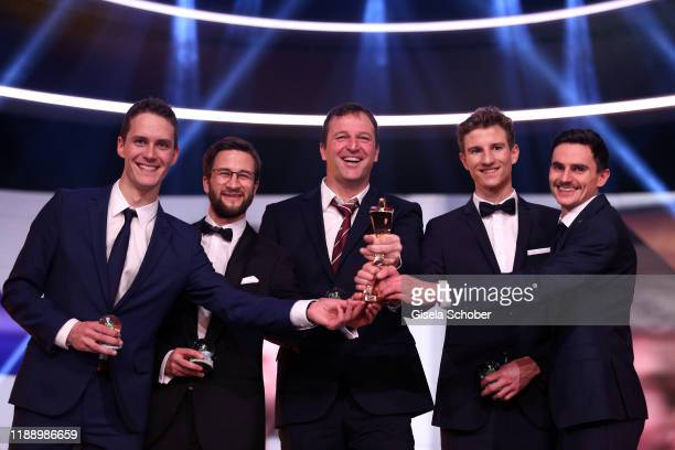 Ski jumping team Stephan Leyhe, Markus Eisenbichler, former coach Werner Schuster, Karl Geiger and Richard Freitag with award during the 'Sportler...