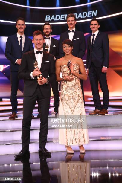 Ski jumping team Stephan Leyhe Markus Eisenbichler former coach Werner Schuster Karl Geiger and Richard Freitag with award front row Long jump gold...