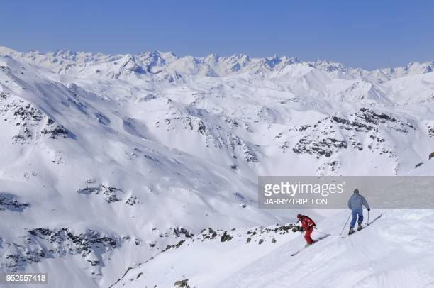 Ski lesson with a ESF ski instructor on off piste skiing from the top of Mont Vallon mountain Meribel ski resort Trois Vallees skiing area Tarentaise...