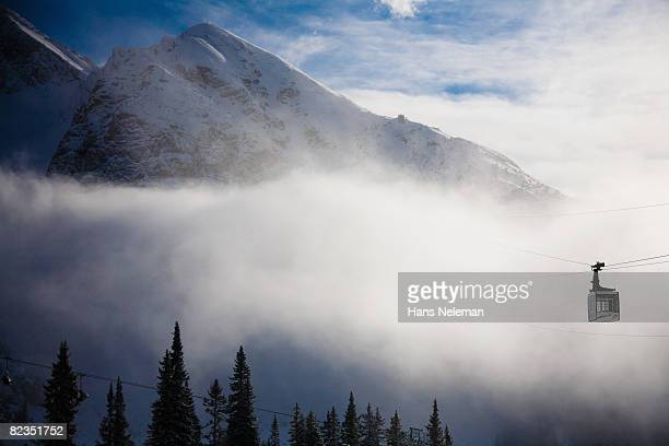 Ski lift moving above trees, Seefeld, Tyrol, Austria