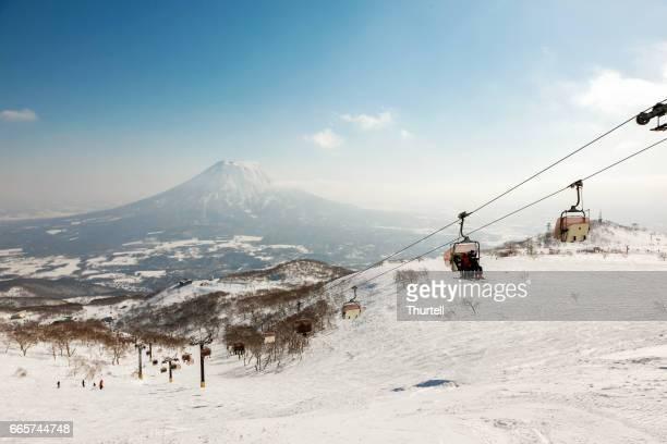 ski lift, niseko village ski resort, hokkaido, japan - hokkaido stock pictures, royalty-free photos & images
