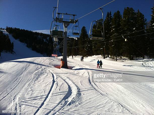 Ski Lift On Snow Covered Field