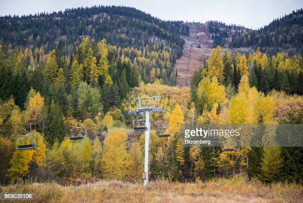 A ski lift sits inactive near golden spruce trees at the Red Mountain ski resort in Rossland British Columbia Canada on Wednesday Oct 18 2017 A tiny...