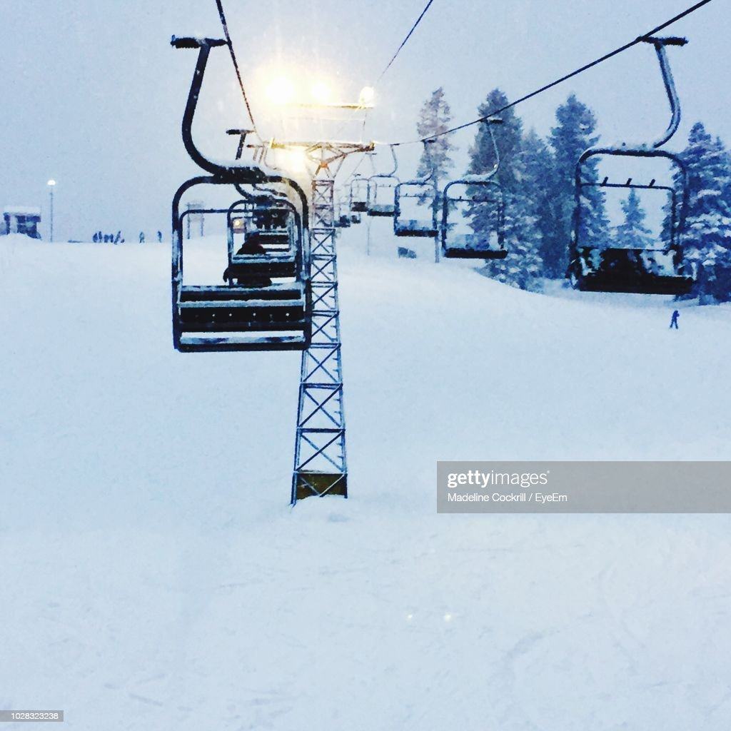 Ski Lifts On Snow Covered Landscape During Winter : Stock Photo