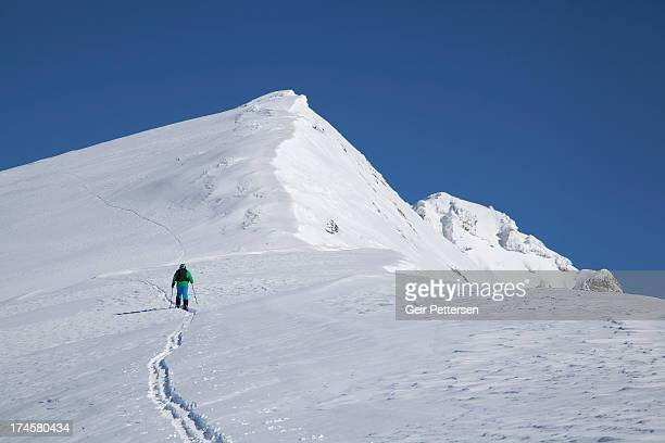 Ski mountaineer climbing peak