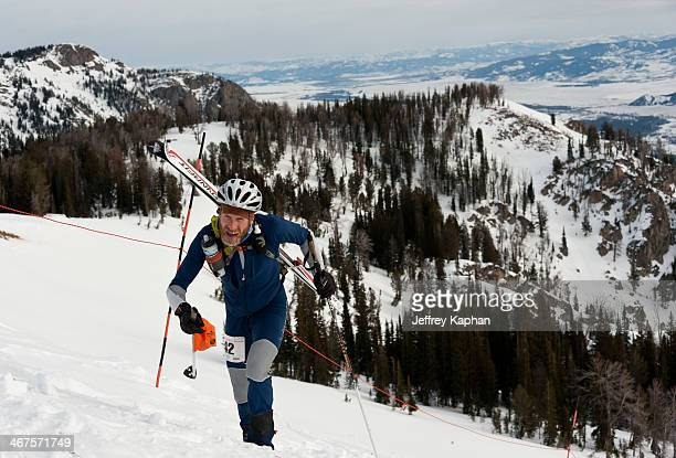 Ski mountaineering racer charging up the Headwall at Jackson Hole Mountain Resort during the 2012 National's. He is wearing a spandex ski suit with...
