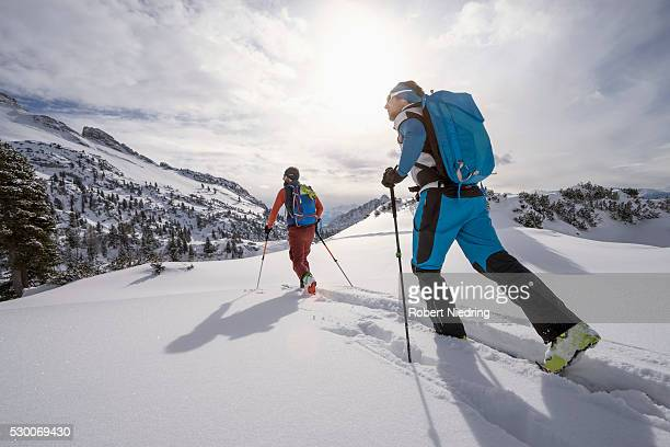 Ski mountaineers climbing on snowy mountain, Tyrol, Austria