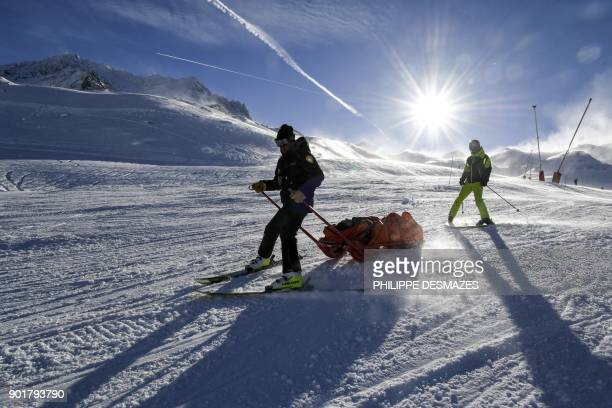 Ski Patrol emergency staff evacuate an injured skier at the Val Thorens ski resort, in the French Alps on January 6, 2018 .