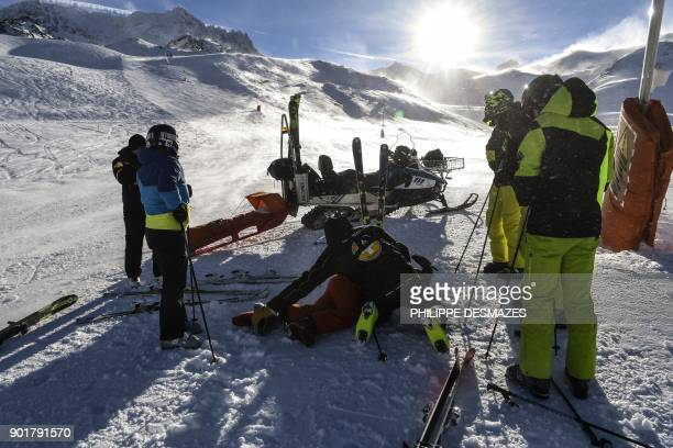 Ski Patrol emergency staff take care of an injured man on a slope at Val Thorens ski resort in the French Alps on January 6 2018 / AFP PHOTO /...