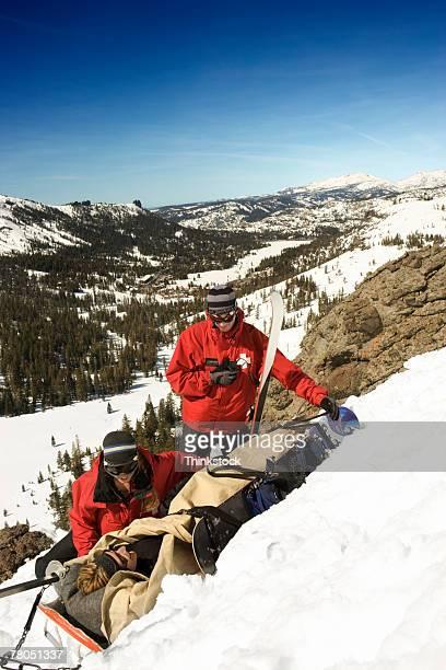 Ski patrol helping injured person