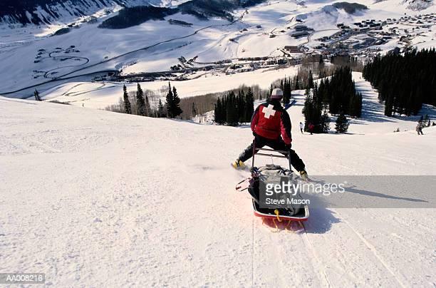 Ski Patrol Member Guiding a Stretcher