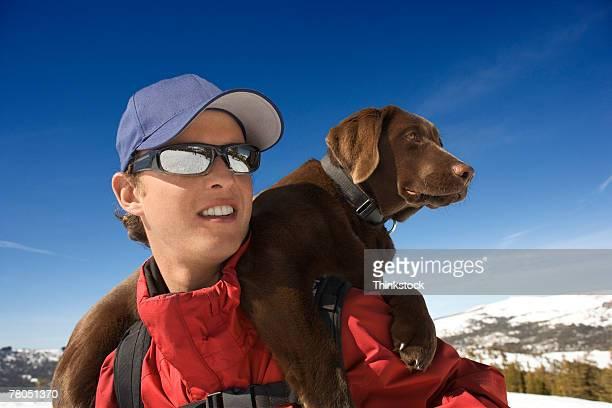 Ski patrol with dog on shoulders
