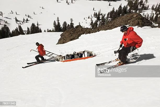 Ski patrol with injured person