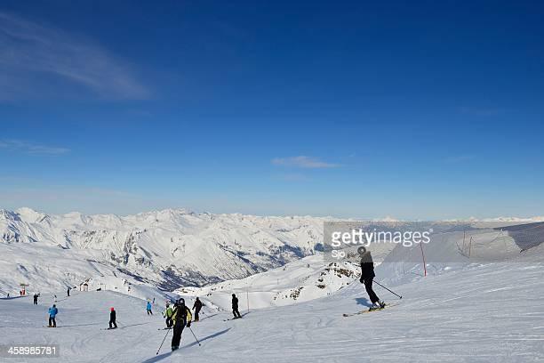 ski piste - trois vallees stock photos and pictures