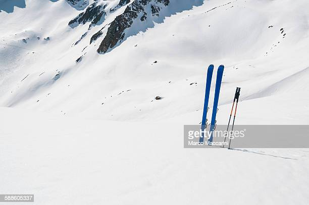 ski planted in the snowy slope - ski pole stock pictures, royalty-free photos & images