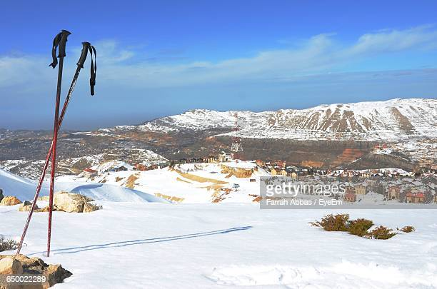 ski poles on snow covered landscape - ski pole stock pictures, royalty-free photos & images