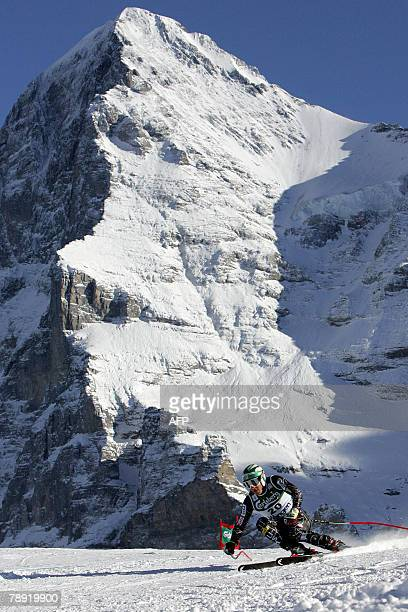 US ski racer Bode Miller passes a curve with the north face of the Eiger mountain as background on his way to win in the Men's FIS Alpine World Cup...