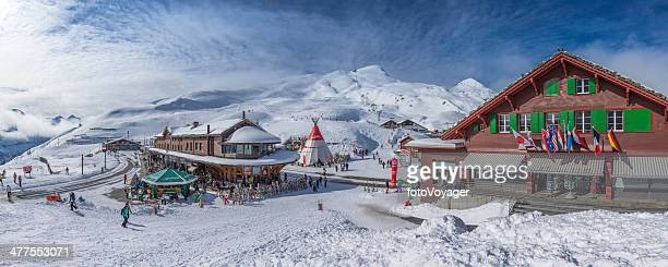 Ski resort and skiers panorama in Kleine Scheidegg Alps Switzerland