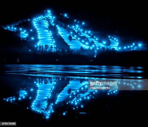 ski resort night lighting in blue - winter sports event stock pictures, royalty-free photos & images