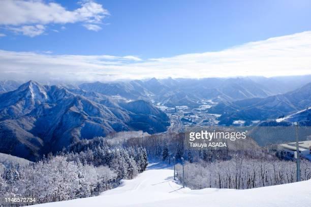 ski slope and snowy mountains - スキー板 ストックフォトと画像