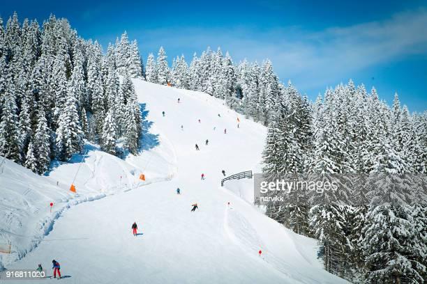 ski slope in kitzbüheler alpen mountains - kitzbühel stock pictures, royalty-free photos & images