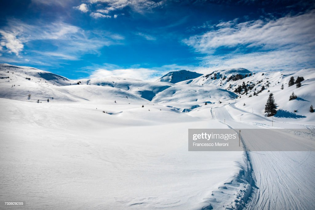 Ski slope on snow covered landscape, Arosa, Swiss Alps, Switzerland : Stock Photo