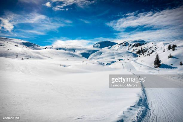 Ski slope on snow covered landscape, Arosa, Swiss Alps, Switzerland