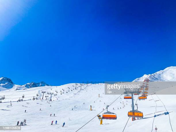 ski slopes and chairlift in the tiroler alps in the sölden ski area in austria during winter. - solden stock pictures, royalty-free photos & images