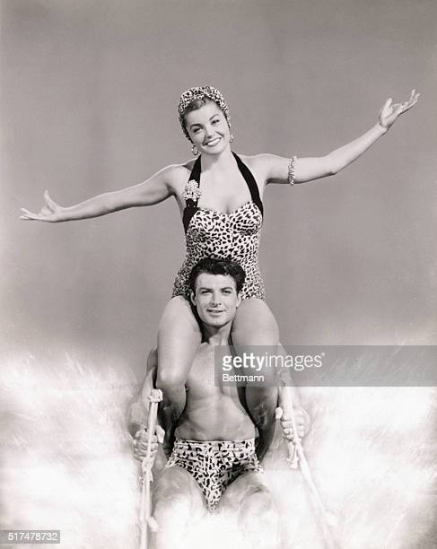 Ski Team Esther Williams sits atop John Bromfield's shoulders to waterski for MGM's Easy to Love Filmed at Cypress Gardens Florida The Technicolor...