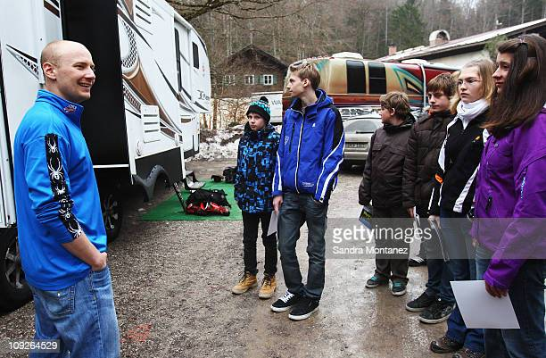 Ski Team nutritionist Adam Korzun answers questions of kids from Munich visiting the USA Ski Team's Mobile Nutrition Center near the Kandahar course...