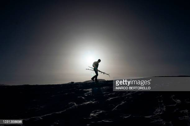 Ski tourer walks at the top of the Col Margherita pass in Falcade, Venetian Alps, on February 24, 2021. - Italy's Health Ministry on February 14...
