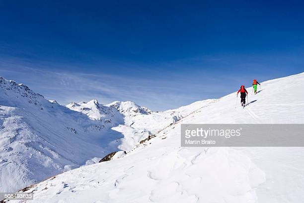 ski touring in the ascent to the kalfanwand in val martello, stelvio national park, province of south tyrol, italy - martell valley italy stock photos and pictures