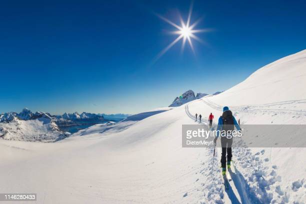 ski touring in the eternal ice,  lofoten - norway - nordic skiing event stock pictures, royalty-free photos & images