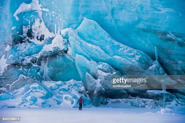 ski touring past an ancient glacier - glacier stock pictures, royalty-free photos & images