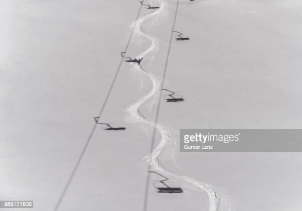 Ski track in deep snow with shadows from a chair lift, Venet, Zams, Tyrol, Austria