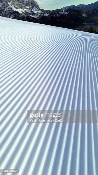 ski tracks on snow covered field - parallel stock pictures, royalty-free photos & images