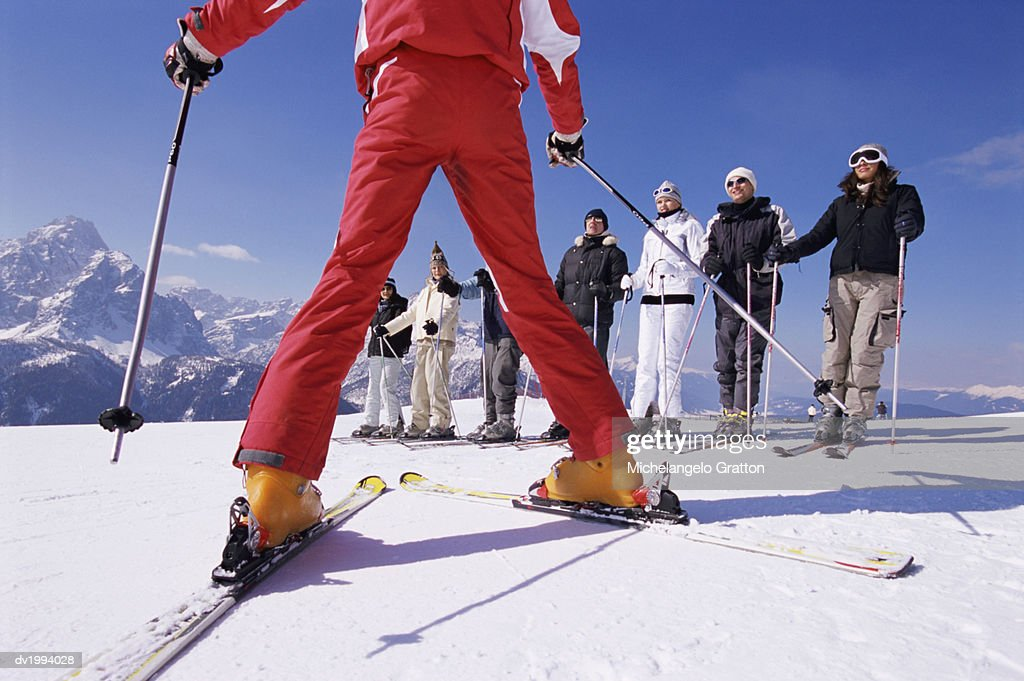 Ski Trainer Teaching Skiers on a Ski Slope : Stock Photo