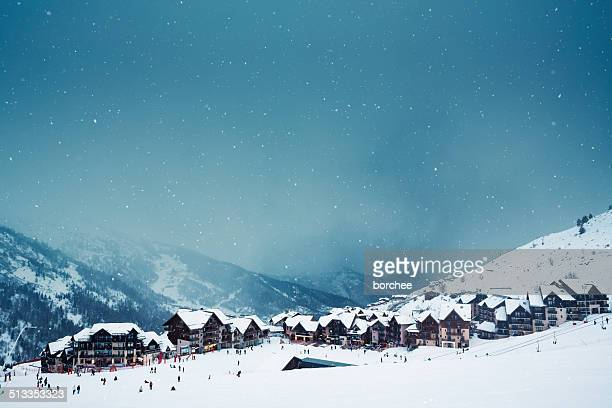 ski village on a snowy day - european alps stock photos and pictures