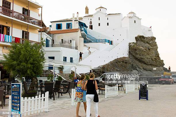 Skiathos Greece 14th August 2012 view on the typical Greek facade of the center of Skiathos with white wall stairs and churches on a mountain in the...