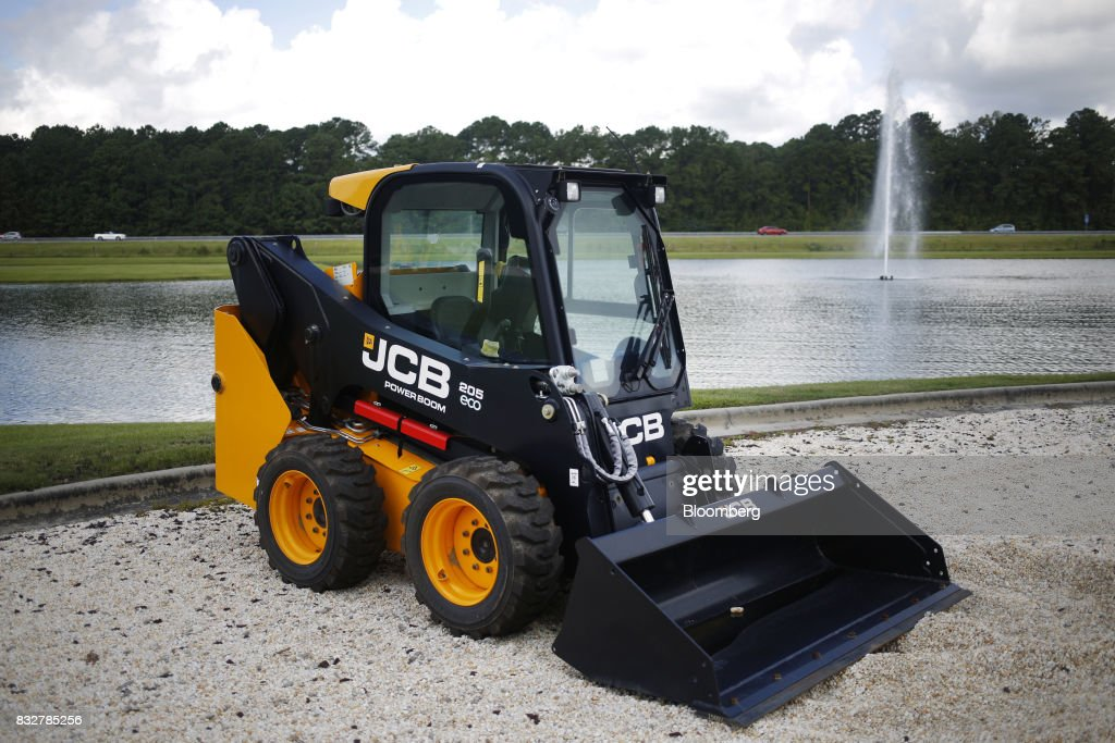 A skid steer loader construction vehicle sits on display at the JC Bamford Excavators LTD. (JCB) manufacturing plant in Pooler, Georgia, U.S., on Friday, Aug. 11, 2017. The Federal Reserve is scheduled to release industrial production figures on August 17. Photographer: Luke Sharrett/Bloomberg via Getty Images